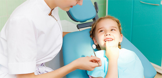 Toronto children's dentist making a young girl laugh