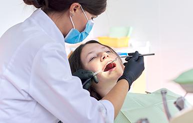 Family dentist works on teenager's teeth in Toronto dental office